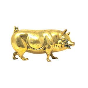 Heavy brass pig door stop