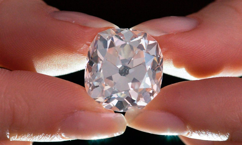 Showcasing the size of the tenner diamond bought at a car boot